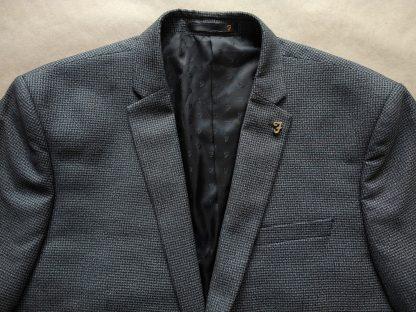 XL . Farah . šedo-černé sako se vzorem kohoutí stopy
