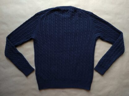 L . Farah . tmavě modrý svetr