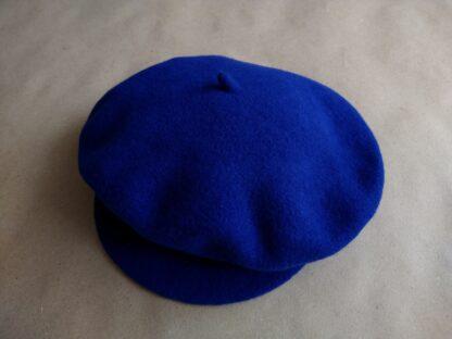 11 . Tonak . tmavě modrý vlněný baret s kšiltem